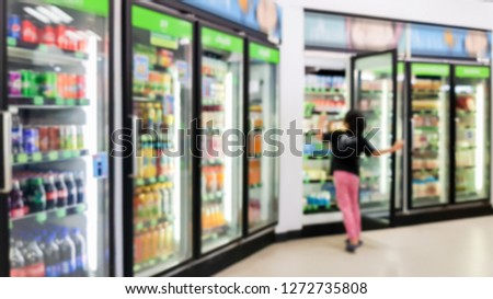 Blurred images of children choosing soft drinks in a convenience store. #1272735808