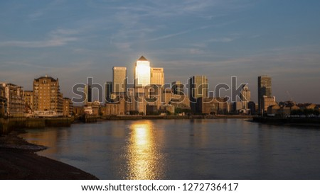 View of Canary Wharf buildings at sunset with sun reflections in London, England, United Kingdom, Europe #1272736417