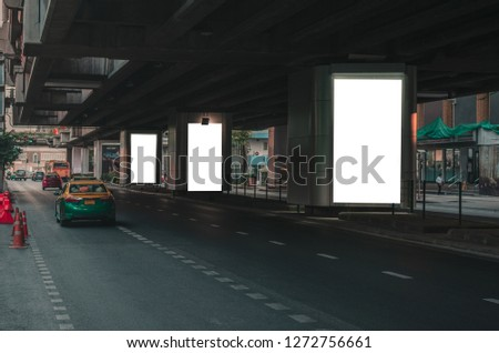 big blank billboard white LED screen vertical outstanding in the city on pathway side the road traffic with car for display advertisement text template promotion new brand at outdoor.