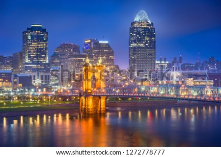 Cincinnati, Ohio, USA skyline on the river at night.