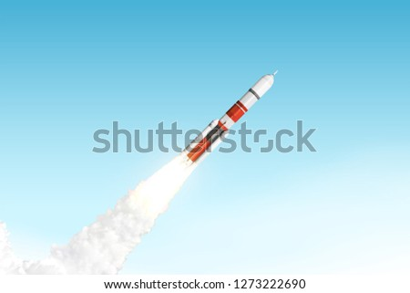 Rocket launching in blue sky. Elements of this image furnished by NASA #1273222690