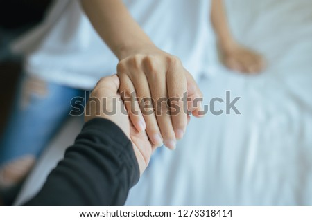 True friendship concept,Asian couples lover holding hands to encourage in times of disappointment or life problems together,Close up #1273318414