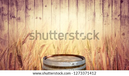 Template of product display - wooden board for alcohol drinks showcase with oak barrel and wheat ears. Horizontal background for your wide billboard of beer beverages with a copy space for text. #1273371412