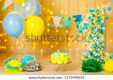 first cake, one year old child, birthday, 2 years old, beautiful photozone in sea style, black-gold background, colored background,