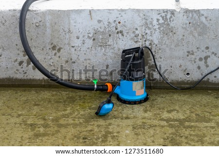 Submersible pump dewater construction site, pumping flood water sing deep well. #1273511680