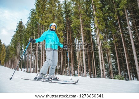 young adult woman skiing. winter sport activity. copy space #1273650541