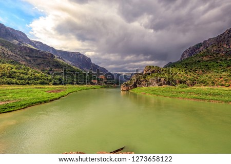 Landscape of the Euphrates River in Kemaliye, Erzincan, Turkey. The Euphrates flows through Syria and Iraq to join the Tigris in the Shatt al-Arab, which empties into the Persian Gulf. Royalty-Free Stock Photo #1273658122