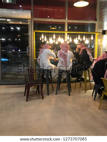 Riyadh, Saudi Arabia - December, 26 2018: Three Saudi men are chatting in a cafe #1273707085