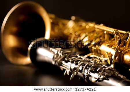 Classic music Sax tenor saxophone and clarinet in black background Royalty-Free Stock Photo #127374221
