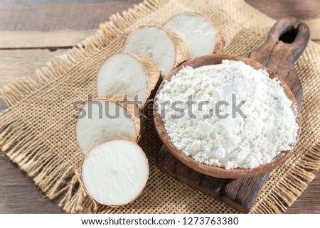 Raw yucca starch on the wooden table - Manihot esculenta.. #1273763380