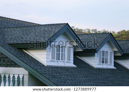 House garret closeup blur sky background Royalty-Free Stock Photo #1273889977