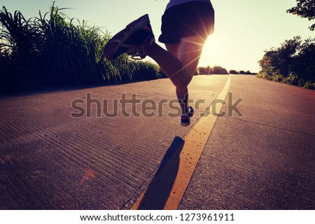Fitness woman running on seaside trail in the morning #1273961911