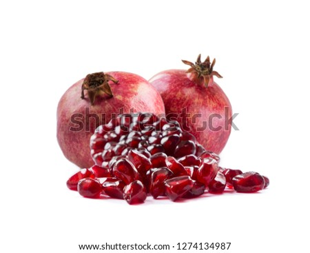 Pomegranate isolated on white background. Sweet and juicy garnet with copy space for text. Garnets isolated on white. Slices of garnets and two garnets fruit isolated on white background. #1274134987
