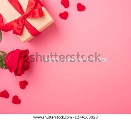 Kraft Gift box with beautiful red ribbon and rose, concept of Valentine's, anniversary, mother's day and birthday greeting, copyspace, topview. #1274163823