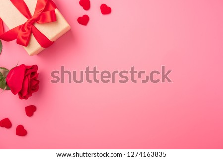 Kraft Gift box with beautiful red ribbon and rose, concept of Valentine's, anniversary, mother's day and birthday greeting, copyspace, topview.