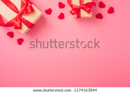 Kraft Gift box with beautiful red ribbon and rose, concept of Valentine's, anniversary, mother's day and birthday greeting, copyspace, topview. #1274163844