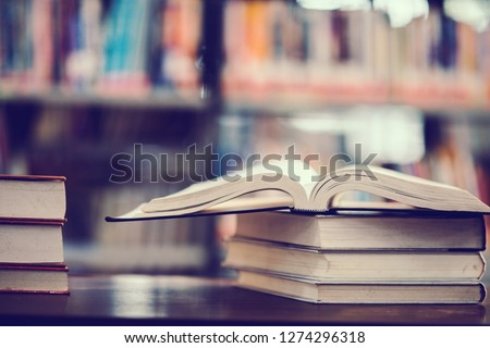 Book in library with open textbook,education learning concept #1274296318