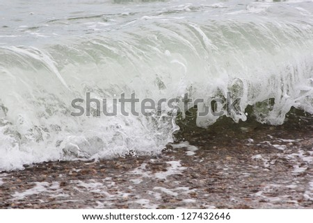 Wave washed over the sandy beach #127432646
