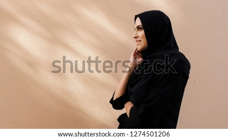 Emirati Arabic woman smiling in side view beauty look  with no filters and color grade