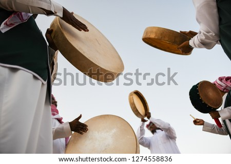 A group of men perform a traditional Saudi Arabian dance and singing in Janadria Festival. #1274558836