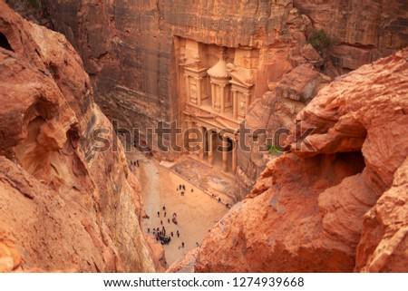 Top view of Al Khazneh - the treasury, ancient city of Petra, Jordan. Nabatean rock-cut temple of Hellenistic period of ancient Petra, originally known to Nabataeans as Raqmu - historical city #1274939668