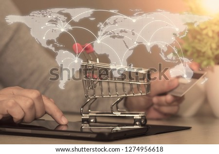 Woman hand using smartphone and holding credit card at home for online shopping is a form of electronic commerce is a transaction of buying or selling goods or services online over the internet. Royalty-Free Stock Photo #1274956618
