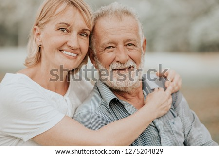Lifestyle Senior Couple Happy and Relaxed . Good Healthy Elderly in Park Nature. Portrait Senior Retirement, Older Couple Enjoy Vacation Autumn. Celebrated Lover Valentine Day. #1275204829