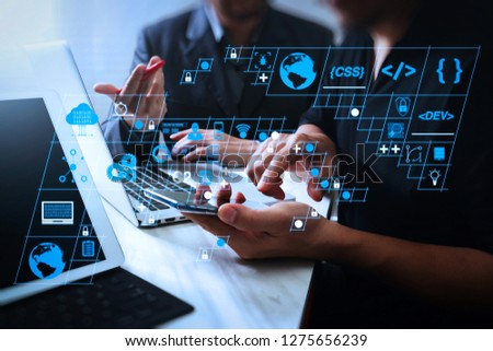 Coding software developer work with AR new design dashboard computer icons of scrum agile development and code fork and versioning with responsive cybersecurity.Business team meeting and Investor. #1275656239