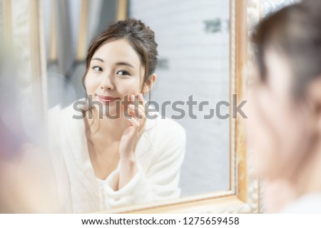 Beauty and skin care concept of a young asian woman. #1275659458