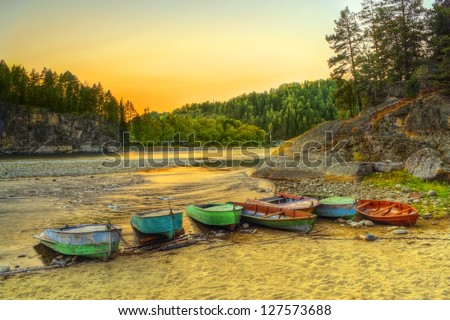 The HDR image of fishermen's berth on Biya river coast in Turochak village (Altai republic, Russia)