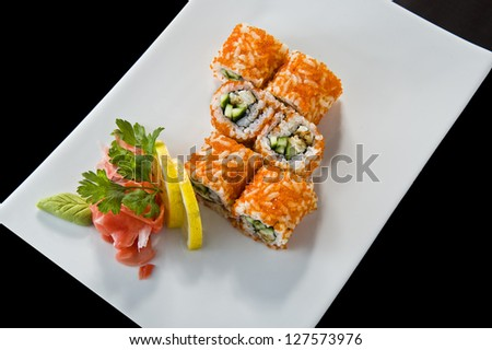 Picture of tasty looking sushi plate .