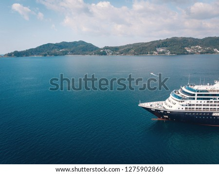 aerial top down view of travel ship nose part in the open sea #1275902860