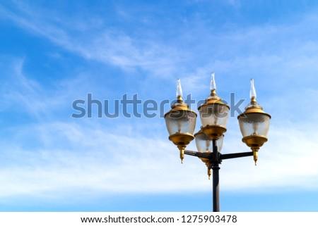 vintage electric lamps post in public park. #1275903478