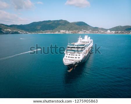 Large Cruise ship sailing across The Andaman sea - Aerial image. Beautiful  sea landscape #1275905863