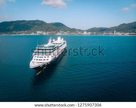 Large Cruise ship sailing across The Andaman sea - Aerial image. Beautiful  sea landscape #1275907306