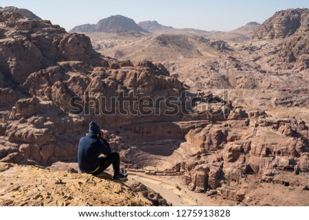 Tourist take picture and enjoy view of Roman theater in Petra ancient city, Jordan, Asia