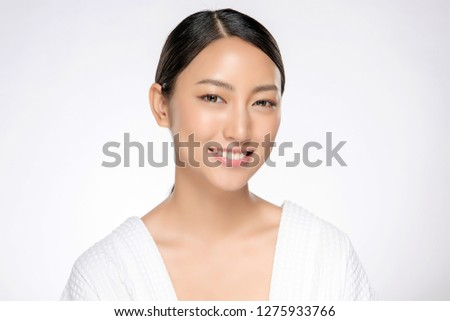 Beautiful smiling woman with clean skin, natural make-up, and white teeth on white background #1275933766