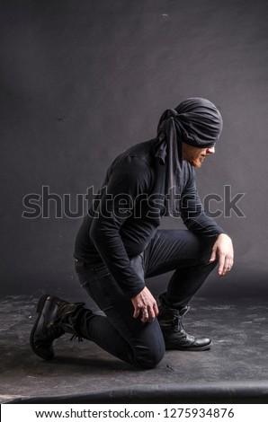 Portrait of a masked super hero on black background. #1275934876