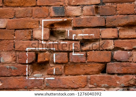 Bullet marks on a brick wall showing the atrocities of British rule in Indian subcontinent during east india rule #1276040392