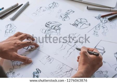 Animator designer Development designing drawing sketching development creating graphic pose characters sci-fi robot Cartoon illustration animation video game film production , animation design studio. #1276063876