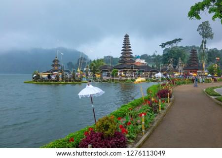 Bali, Indonesia - March 24, 2017:  The ancient pagodas of the Ulun Danu temple on  the Beratan lake riverside #1276113049