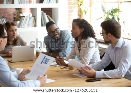 African young project manager speaking at diverse meeting sharing creative ideas telling opinion at group briefing, black female employee talking reporting about corporate work result, team listening Royalty-Free Stock Photo #1276205131