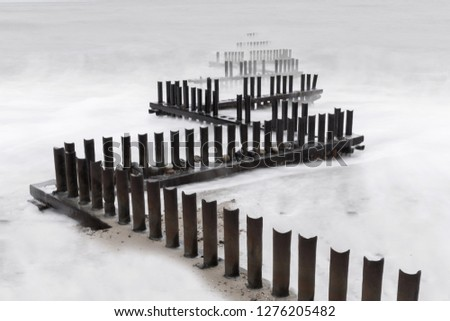 Wooden sea barriers in Norfolk #1276205482