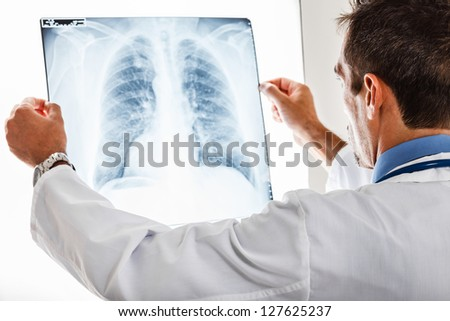 Doctor examining a lung radiography Royalty-Free Stock Photo #127625237