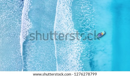 Beach and waves from top view. Turquoise water background from top view. Summer seascape from air. Top view from drone. Travel concept and idea #1276278799