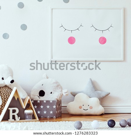 Stylish scandinavian child room with mock up photo poster frame on the pattern wall, boxes, teddy bear and toys.Cute modern interior of playroom with white walls, wooden accessories and colorful toys. #1276283323