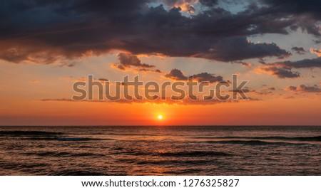 Beautiful cloudscape over the sea, sunrise shot #1276325827
