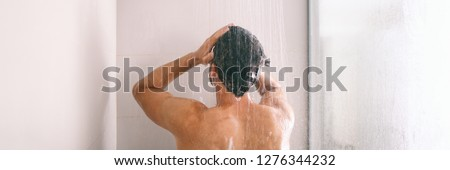 Shower man washing hair rinsing shampoo in bathroom banner panorama. Showering person at home lifestyle. Young guy taking a shower. #1276344232