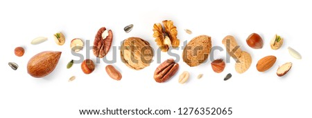 Creative layout made of hazelnut nuts, almonds, walnut, peanut, pecan, sunflower seeds on white background.Flat lay. Food concept. #1276352065