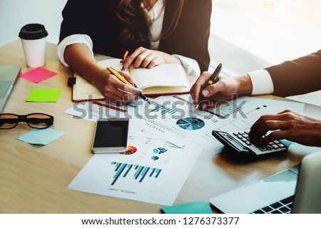 Financial advisor, accounting and Investment concept, business owners consult adviser financial meeting to analyze and  on the finance report in the his office room. #1276373377